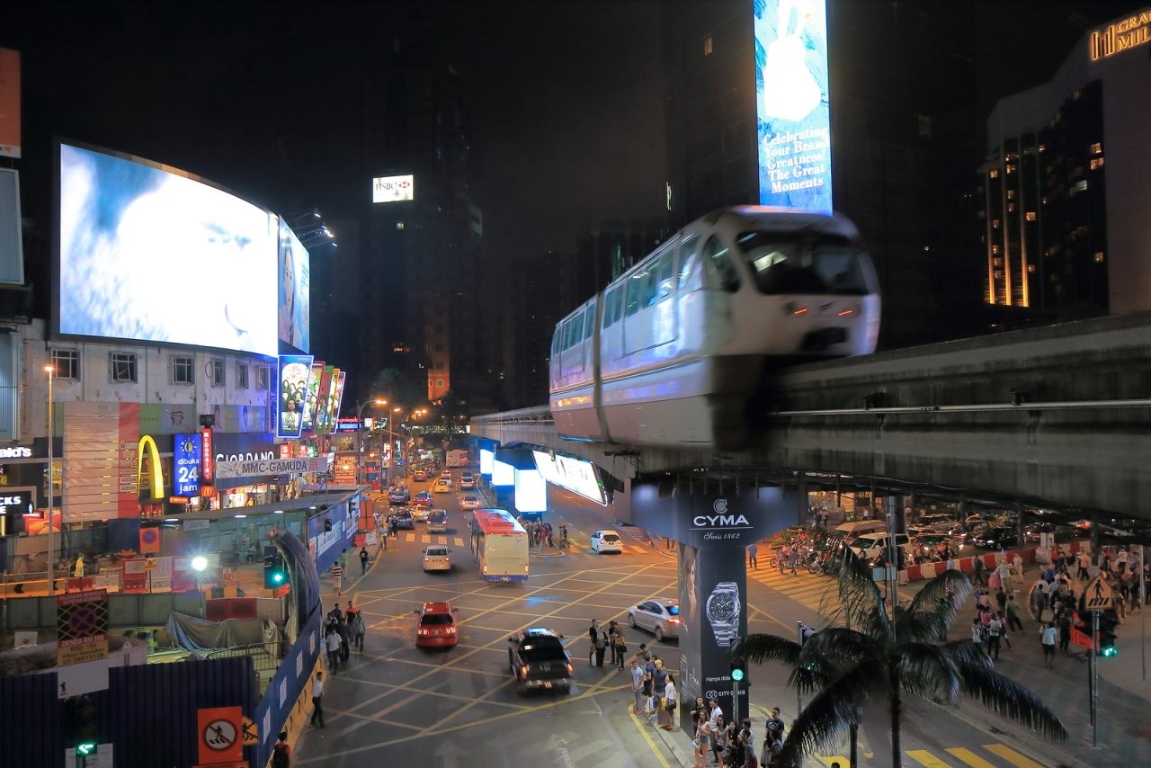 bigstock-Bukit-Bintang-and-monorail-nig-67818838