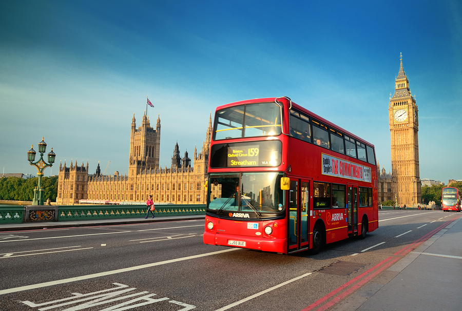 LONDON, UK - SEP 27: Street view with Big Ben and red bus on Sep