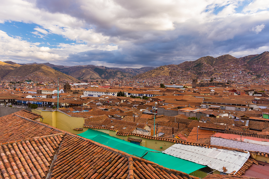 Cityscape of Cusco at sunset with dramatic sky and storm clouds. Cusco is among the most important travel destination in Peru and the entire South America.