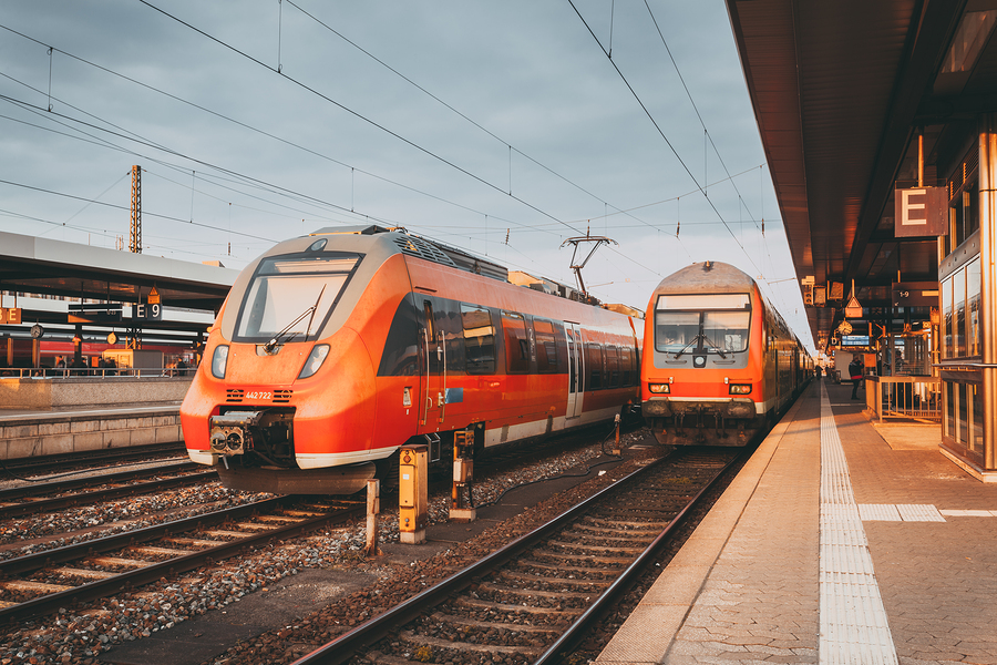 High Speed Red Commuter Trains At The Railway Station