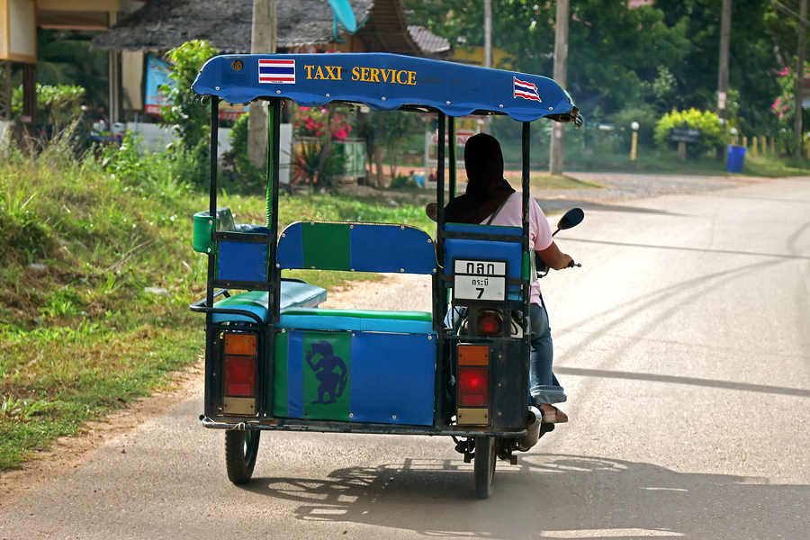 KRABI, THAILAND - MAY 2014 : Woman with black headscarf driving