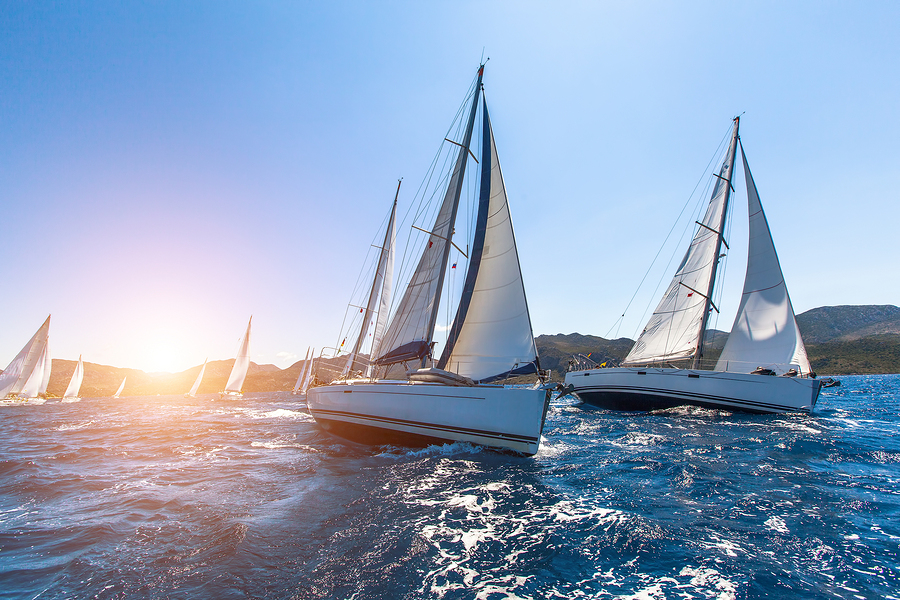 Luxury yachts at Sailing regatta. Sailing in the wind through th